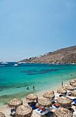 Thatched umbrellas on Ornos Beach, Mykonos Town, Mykonos, The Cyclades, The Greek Islands, Greece