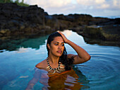 Young Samoan woman bathing, Samoa