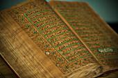 Intricate text of an old Koran at Brunei's Dar al-Salam's Islamic Museum, Bandar Seri Begawan, Brunei