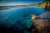 Exploring the reef that rings Niue Island, Niue