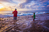 Father and son fishing on Niue Island, Niue