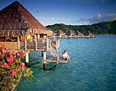 Couple relaxing at an overwater bungalow, Bora Bora