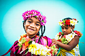 Two young girls in fresh floral garlands, Tuvalu