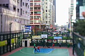 An outdoor basketball court in an urban area, Hong Kong