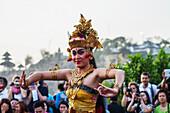 Balinese dancers using codified hand positions and gestures during a Kecak dance performance, Ulu Watu, Bali, Indonesia