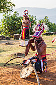 Manggarai men wearing traditional headdress wrapped with cloth and wielding shields and bamboo whips before a caci, a ritual whip fight, Melo village, Flores, East Nusa Tenggara, Indonesia