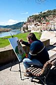 Artist Painting The Views Of Miravet, Ebro River And Castle, Miravet, Tarragona, Spain