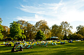 People Sunbathing On A Spring Day In Green Park, Central London, London, Uk