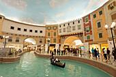 Electric gondola on canal in the Villagio shopping mall, Doha, Qatar