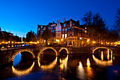 Bridges over canals at dusk, Amsterdam, Holland