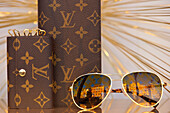 Louis Vuitton glasses and purses on display in window of De Bijenkorf, Amsterdam, Holland