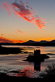 Silhouette of Castle Stalker at dusk, Appin, Argyll and Bute, Scotland