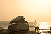 A Volkswagen camper van parked along the seafront, Broadstairs, Kent, England