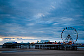 Blackpool central pier reaches out into the sea, Blackpool Pleasure beach, Blackpool, Lancashire, England