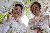 Women as costumed characters in St. Peter's village tour, Broadstairs, Kent, England