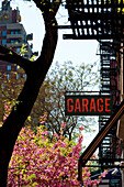 Garage Sign And Springtime In The West Village, Manhattan, New York, Usa