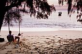 Relaxing on a beach swing, Bamboo Island, Cambodia