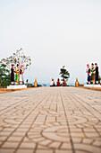 Relaxing atop the hilltop stupa, Luang Namtha, Laos