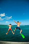 Snorkellers jumping into the waters off Uplulu Island, Upulu, Samoa