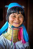 Kayan woman with brass neck coils, Burma
