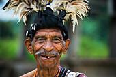 Elderly man in traditional attire, Lospalmos district, Timor-Leste