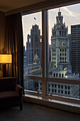 'View of Wrigley Building and Tribune Tower (with flag) from 20th-floor bedroom at Trump International Hotel and Tower; Chicago, Illinois, United States of America'