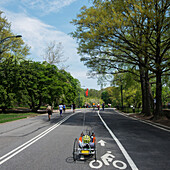 'Pedestrians, runners and cyclists on a park path; New York City, New York, United States of America'