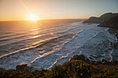 'Waves lapping the coast at dusk; Oregon, United States of America'