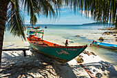 'Boats on the white sand shore of Koh Rong Island; Sihanoukville, Cambodia'