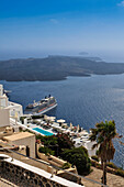 'Ships in the harbour of Thera, with the Island of Nea Kameni in the background; Thera, Santorini, Greece'