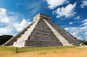 'Ancient Mayan Pyramid with two large serpent heads with their mouths open and white clouds and blue sky; Chichen Itza, Yucatan, Mexico'