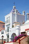 'Traditional architecture, lamppost and blue sky; El Porto de La Santa Maria, Andalusia, Spain'