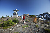 'Hiking and sightseeing on Whistler Mountain on a beautiful summer day; Whistler, British Columbia, Canada'