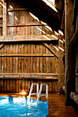 A Ladder In A Pool Inside A Barn, Montreal, Quebec