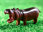 Close Up Of Miniature Toy Hippo On Artificial Grass