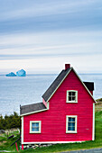 Red Cabin With Icebergs In The Background, Newfoundland