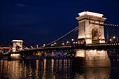 Szechenyi Chain Bridge Over The Danube River At Night, Budapest, Hungary