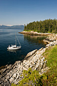 Sailboat anchored off of Perry Island in Prince William Sound, Southcentral Alaska.