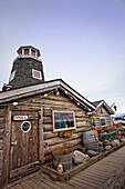 The exterior of historic Salty Dawg Saloon on Homer Spit, Homer, Southcentral Alaska, Spring.