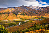 Scenic view of Brooks Range, Dietrich River and the Dalton Highway, Gates of the Arctic National Park & Preserve, Arctic Alaska, Autumn.
