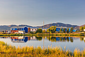 Colorful houses in the village of Shungnak, along the bank of the Kobuk river on a calm sunny day, Arctic Alaska, Summer