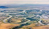 Aerial view of the Kobuk River and surrounding wetlands with the Baird Mountains visible in the background, Arctic Alaska, summer