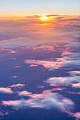 Aerial view of a partly cloudy sunrise in Arctic Alaska, summer