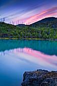 Pastel colored sunset over Skilak Lake, Kenai National Wildlife Refuge, Southcentral Alaska, Summer.