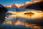 Sunrise view of Portage Glacier with icebergs and Byron Peak in the background, Chugach National Forest, Kenai Peninsula, Southcentral Alaska, Summer.