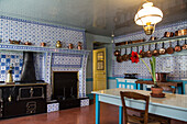 the kitchen in blue tiles from rouen, the impressionist painter claude monet's house, giverney, eure (27), normandy, france