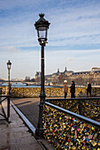 the pont des arts bridge links the quays malaquais and conti, at the institut de france, to the francois mitterrand and louvre quays, the bridge is known for the love padlocks that cover the guardrail, paris (75), ile-de-france, france