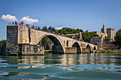 saint benezet bridge, called the bridge of avignon, situated on the rhone, the popes' palace and the cathedral notre dame des doms, city of avignon, called city of the popes and listed as a world heritage site by unesco, vaucluse (84), france