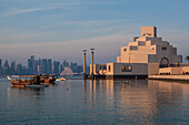 view of the museum of islamic art built by the architect ieoh ming pei, and of west bay and the skyline of the city center of doha, qatar, persian gulf, middle east