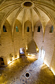 on the ground floor, the guardsÆ room in the constance tower with a statue of saint louis and its entry protected by a portcullis. in the center of the room a circular opening allows access to the basement that served as pantry, munitions room and also ja